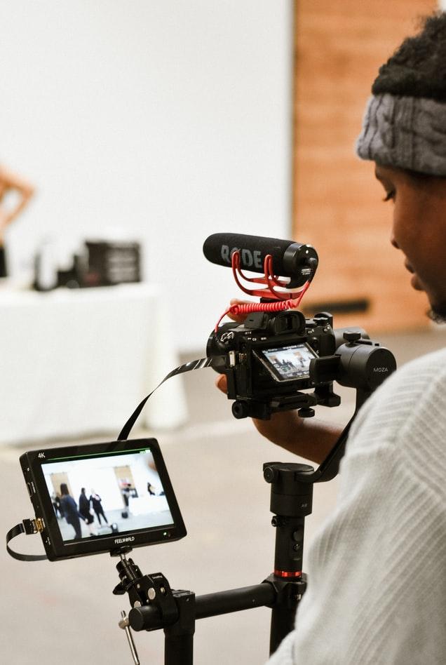Person using small digital camera